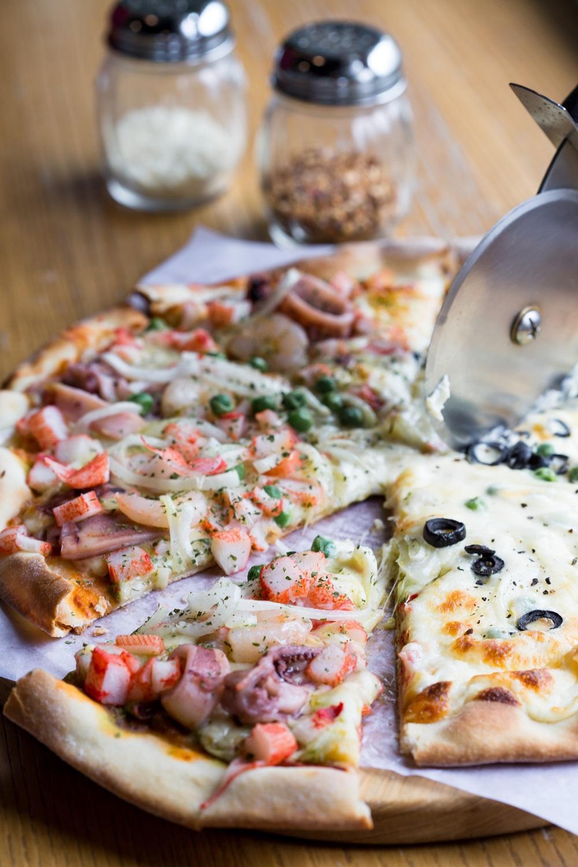 店內的每款披薩都是阿米哥手工薄皮披薩店主劉敏安親自研發,並堅持在食材原料上下重本。