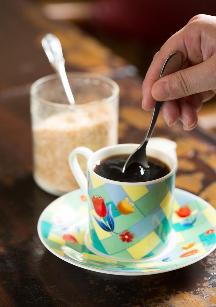 老闆以塞風壺現煮的「招牌咖啡」,是常客的心頭好。(180元/杯)