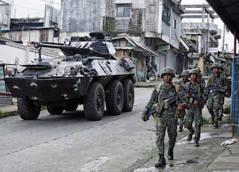 菲律賓南部民答那峨島因有回教叛軍及IS作亂,杜特蒂5月宣布民答那峨島戒嚴2個月。(東方IC)