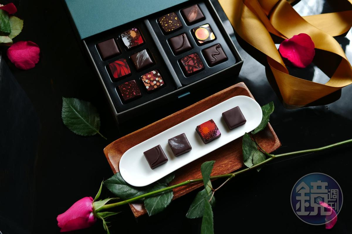 「畬室法式巧克力甜點創作」的夾心巧克力「台灣」「一翦梅」「百香薑花」「陳釀醬油」,放入嘴裡要用咬的,同時感受甘苦、滑順及各種香氣。(畬室法式巧克力甜點創作,白盤內由右向左,85元/單片、1,200元/12入)