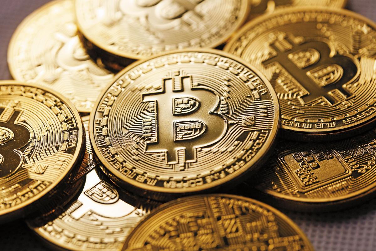 比特幣是虛擬貨幣,沒有實體,媒體只能以想像的圖示意。(東方IC)