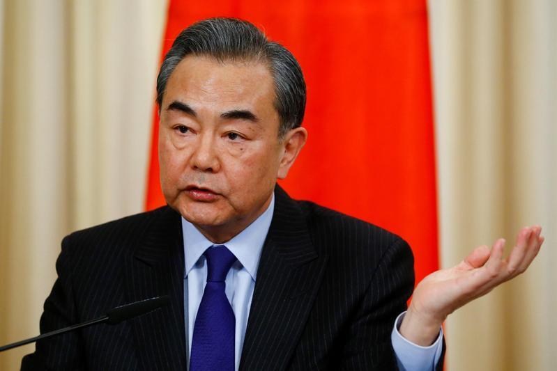 中國國務委員兼外交部長王毅(圖)今在北京與多明尼加外長瓦嘉斯簽署聯合公報。(東方IC)