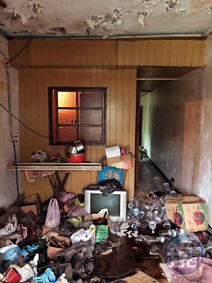 過去盧致宏曾處理過推滿雜物、屋況極差的房子,除了清潔也幫忙拆除老舊的木板隔間。(盧致宏提供)