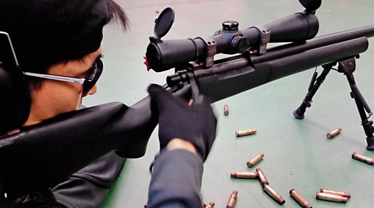 特勤隨扈個個身手矯健,制高點狙擊也是必要訓練的一環。(國安局提供)
