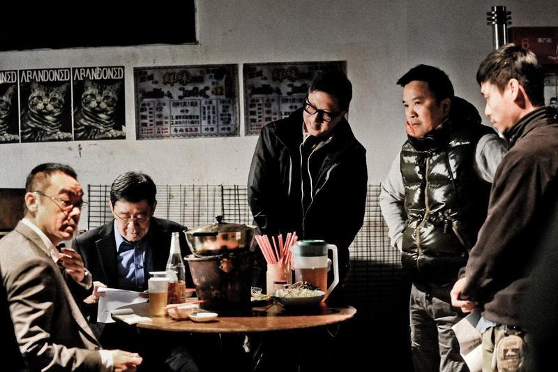 麥兆輝(右2)與莊文強(中)聯合編導的《竊聽風雲2》曾入圍香港電影金像獎最佳導演與編劇。(東方IC)