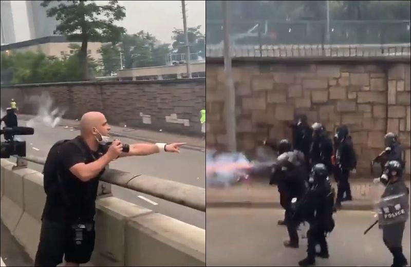 港警針對各國記者開槍清場,有人目擊法國記者毫無畏懼,繼續拿著相機對港警喊話「這是香港,還不是中國」。(翻攝自Youtube)