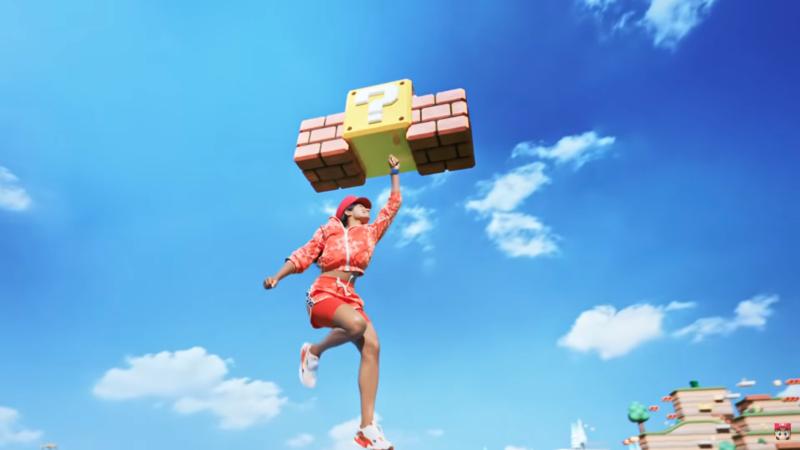 新公布的任天堂主題樂園MV中,出現真人敲磚塊的畫面;官方表示這會將在實體的樂園中呈現。(翻攝自Nintendo YouTube頻道)
