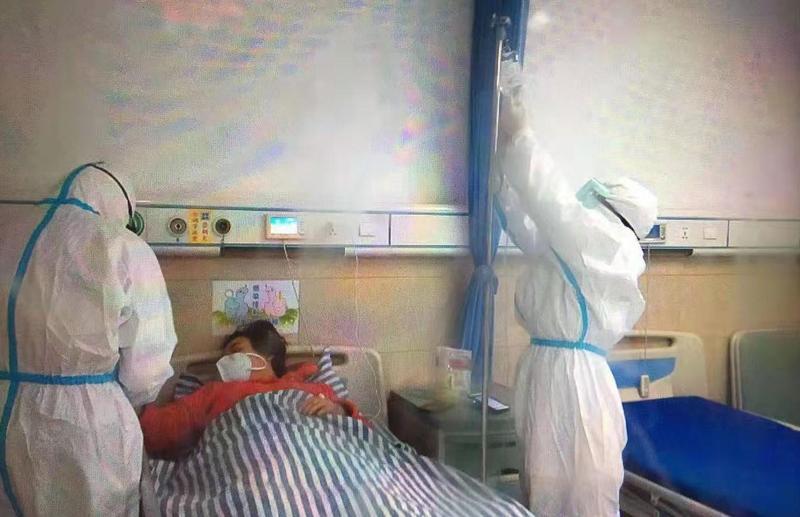 居家隔離14天後,文姓婦人確診武漢肺炎。圖為示意圖,當事人與本新聞無關。(翻攝自微博)