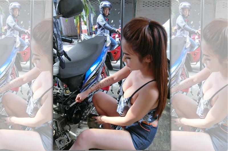 有一名網友附上一張爆乳辣妹修車的照片,跪求車行地址。(翻攝推特)