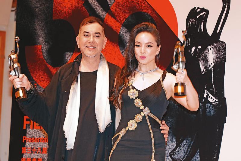 黃秋生(左)去年以電影《淪落人》三度獲香港電影金像獎最佳男主角,並透露拍此片時沒拿任何酬勞。右為曾美慧孜。(東方IC)