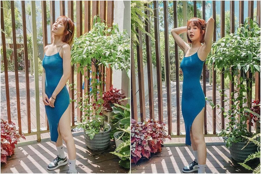 舒子晨身穿藍綠色細肩帶洋裝,貼身設計讓她的曲線一覽無遺。(翻攝自舒子晨IG)