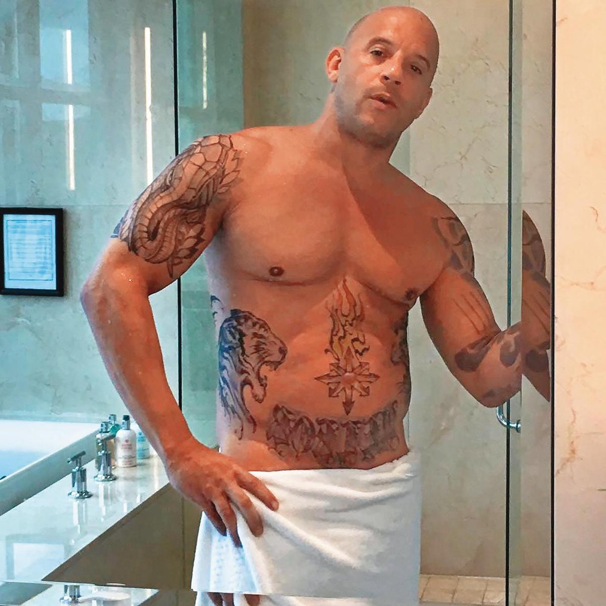 蔣友柏越練越壯,加上光頭、手臂刺青,神似好萊塢肌肉巨棒馮迪索。(翻攝自馮迪索IG)