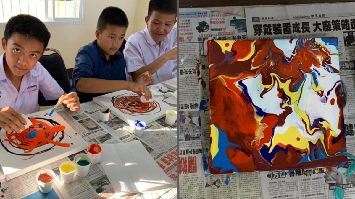 吳庭逸曾到泰國參與公益活動,教導孩子繪製流動畫。(吳庭逸提供)